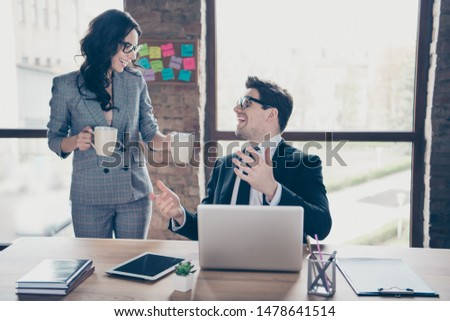 Photo of relaxing cheerful business people having achieved all goals set and found moment to drink some coffee and talk while distracting from their work #1478641514