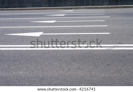 photo of road signs arrows on asphalted surface