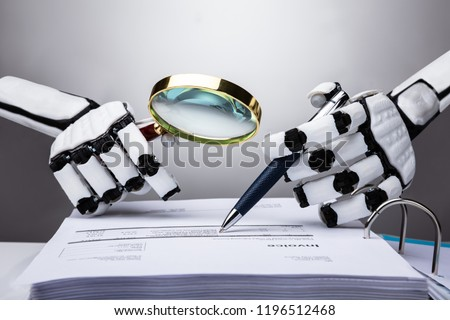 Photo Of Robot Examining Invoice With Magnifying Glass Stock foto ©