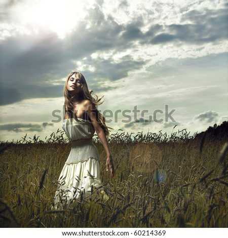 Photo of romantic woman in wheat field