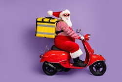 Photo of santa claus drive moped deliver food wear bag x-mas costume striped shirt cap eyewear isolated violet color background