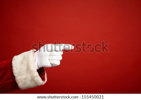 Photo of Santa Claus gloved hand in pointing gesture