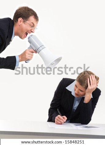Photo of scared businesswoman closing her ears by hands while boss screaming into loudspeaker at workplace