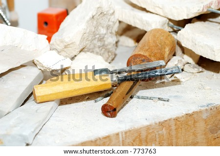 Photo of Sculptor Tools and Pieces of Marble