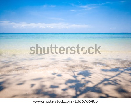 Photo of sea view with white sandy beach , blue sky and shadow of tree's branch at Ao Sai bay in Koh Yao, nobody here