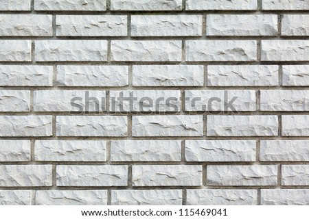 photo of section of brick wall of gray color close-up - stock photo