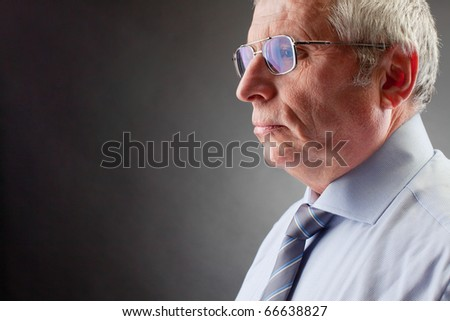 Photo of senior employer on black background