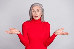 Photo of senior woman happy positive smile shrug shoulders clueless confused no answer isolated over grey color background