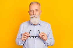 Photo of serious calm old man hold hands glasses wear shirt formalwear isolated on yellow color background
