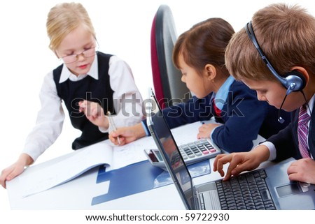 Photo of serious lad with headset typing on background of communicating girls