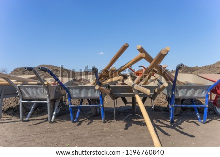 Photo of several wheel barrows full of instruments in the field #1396760840