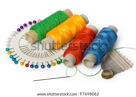 Photo of sewing accessories (threads, pins and needle) on a white background - stock photo
