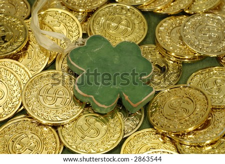 Photo of Shamrock and Gold Coins - Luck of the Irish Concept