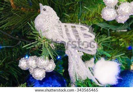 Photo of silver bird decoration on christmas tree. #343565465