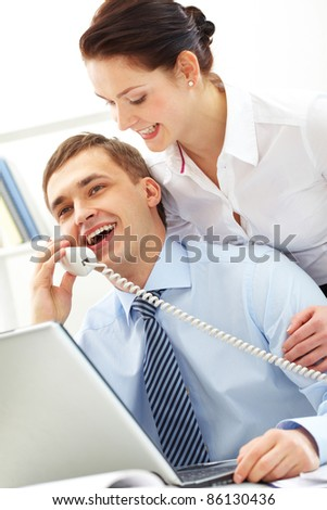 Photo of smart businessman calling with secretary near by
