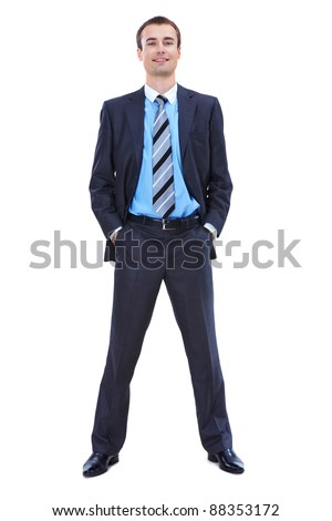 Photo of smart businessman in suit posing in front of camera over white background
