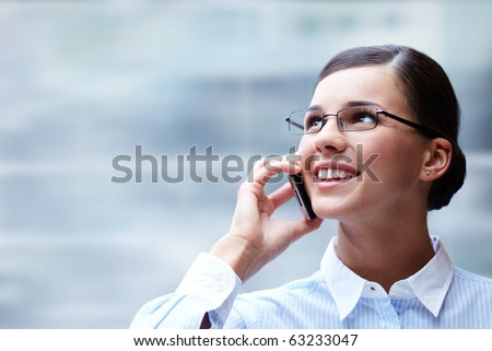Photo of smart businesswoman calling somebody and smiling