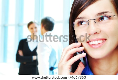 Photo of smart businesswoman calling with interacting people behind
