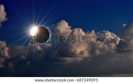 Shutterstock Photo of solar eclipse and cloudy sky, natural phenomenon