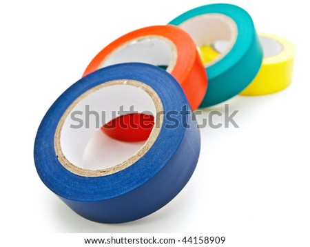 Photo of some multicolored insulating tapes against the white background