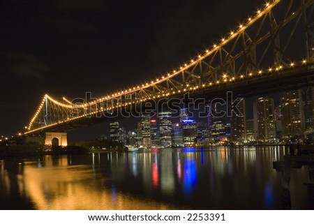 photo of story bridge by night with cityscape in background