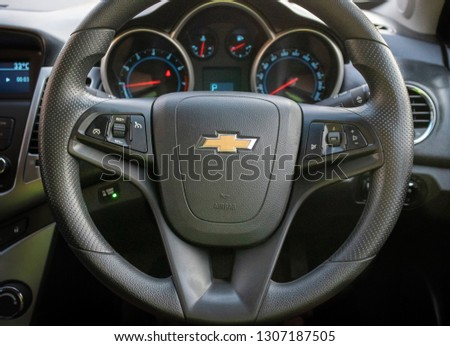 Photo of Straight position of Chevrolet steering wheel on the driver seat of Chevrolet Cruise 2015 edition, Bangkok Thailand November 25, 2017 #1307187505