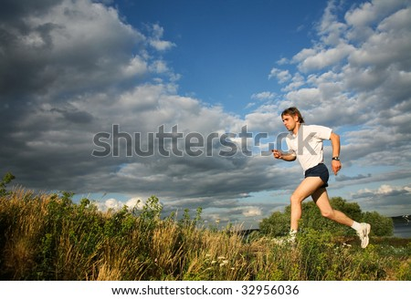 Photo of strong man running along the river