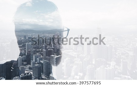 Photo of stylish bearded lawyer wearing trendy suit and looking city. Double exposure, panoramic view contemporary City background. Space for your business message. Wide
