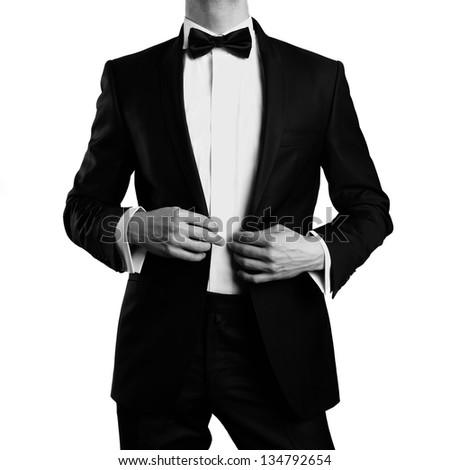 Photo of stylish man in elegant black suit - stock photo