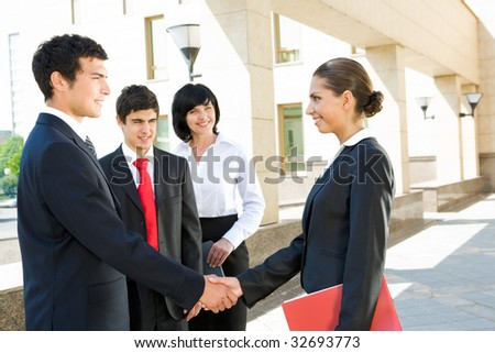 Photo of successful people handshaking after striking deal outdoors at meeting