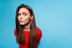 Photo of suspicious lady look distrustful on camera wear red knitted sweater isolated blue color background