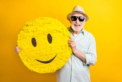 Photo of sweet cool age gentleman wear green shirt spectacles headwear holding big smiley isolated yellow color background