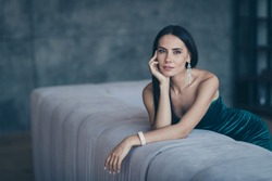Photo of tenderness classy lady leaning on comfortable sofa waiting boyfriend home wear teasing classy formalwear short shiny dress apartments indoors