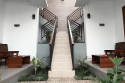 Photo of the backyard with stairs leaving the house on the street with a handle
