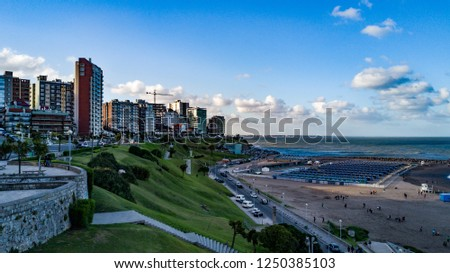 Photo of the beach and the sea of ​​the city of Mar del Plata, Buenos Aires, Argentina. Drone Waves. Ocean. Mar. holidays. Summer.