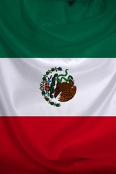 photo of the beautiful vertical, colored national flag of mexico state on a textured fabric, concept of tourism, economics and politics, closeup