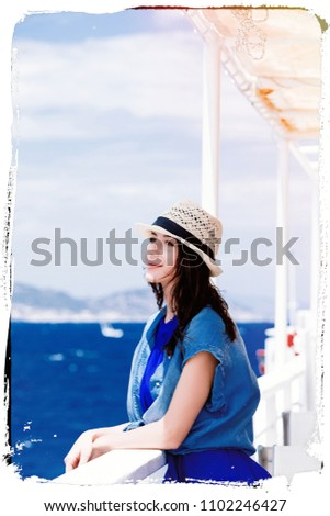 photo of the beautiful young woman standing near the iron railing of the boat and looking at the splendid view in Greece . Image made with old film frame. Zdjęcia stock ©