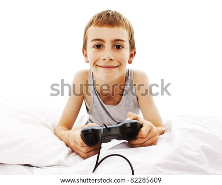 Photo of the boy with joystick playing computer game