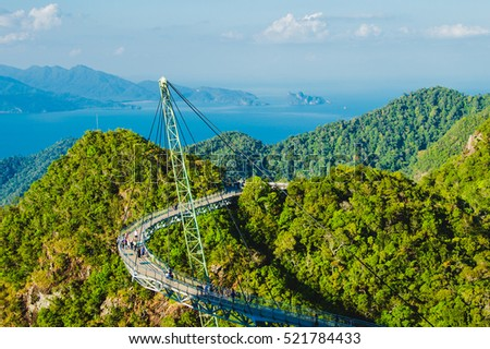 Photo of the Breathtaking aerial landscape with Sky bridge, symbol Langkawi, Malaysia. Adventure holiday. Modern technology. Tourist attraction. Travel concept. Andaman sea background #521784433