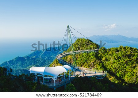 Photo of the Breathtaking aerial view with cable-stayed bridge, symbol Langkawi, Malaysia. Adventure holiday. Modern technology. Tourist attraction. Travel concept. #521784409