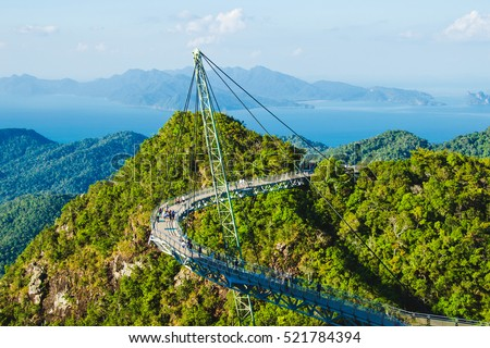 Photo of the Breathtaking aerial view with Sky bridge, symbol Langkawi, Malaysia. Adventure holiday. Modern technology. Tourist attraction. Travel concept. Andaman sea background #521784394