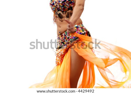 Photo of the dancing active woman in orange costume