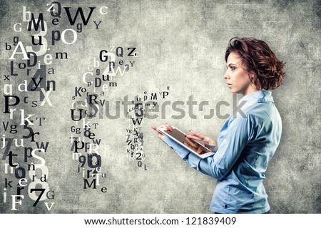 Photo of the girl with a computer in a hand