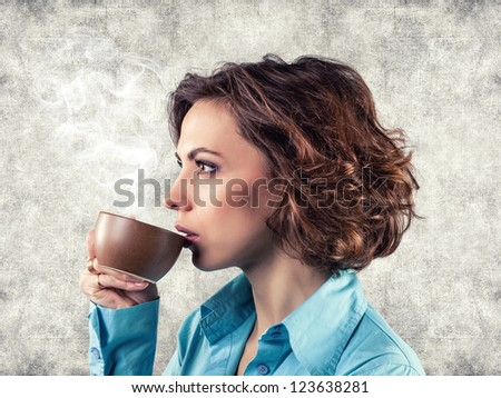 Photo of the girl with a cup of hot tea