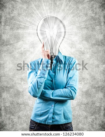 Photo of the girl with lightbulb instead of a head