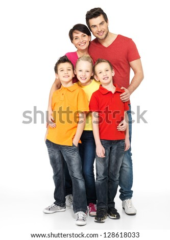 Photo of the happy young family with two children isolated on white background