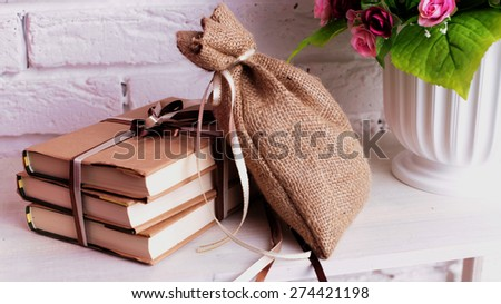 Photo of the interior of the gift books with a bag lying on the shelf