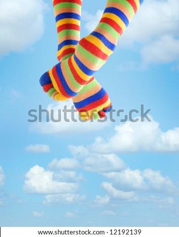 Photo of the legs in zebrine socks sitting in the sky