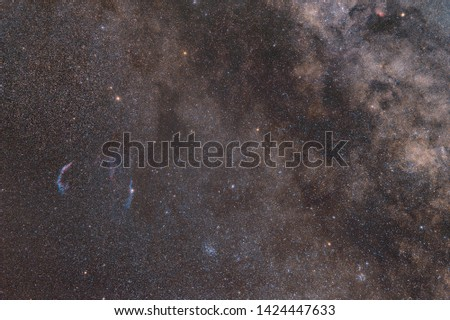 Photo of the Milky Way. Cosmic light and cosmic dust. Photo space. Red hydrogen nebula and blue stars. Astronomical observations of space. Mysterious space.