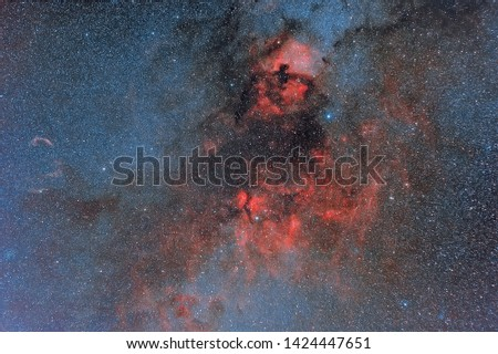 Photo of the Milky Way. Cosmic light and cosmic dust. Photo space. Red hydrogen nebula and blue stars. Astronomical observations of space.